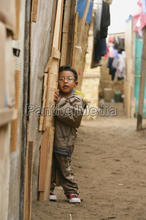 young boy in alleyway lima peru