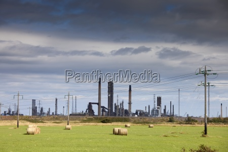 a refinery with hay bales in