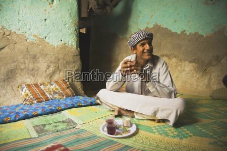 berber man having tea inside his