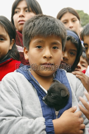 young boy with puppy lima peru