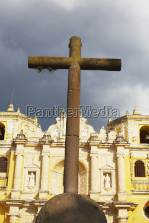 antigua guatemala a cross in front