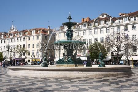 fountain in plaza rossio lisbon portugal