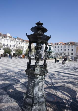 a statue in rossio lisbon portugal
