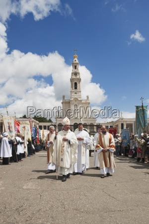 religious leaders walk through the crowd