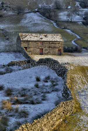 a barn and stone walls with