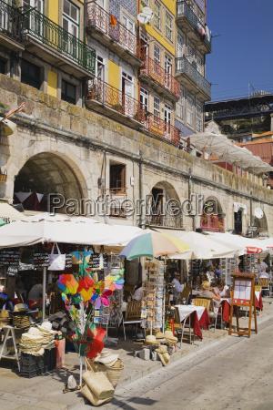 souvenir shops below apartment buildings porto