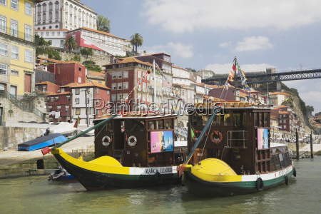 sightseeing boats moored on the douro