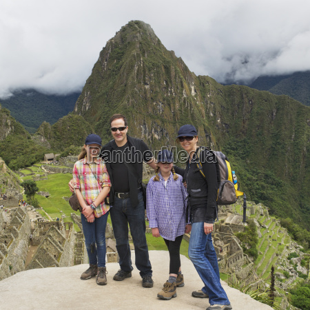 a family at machu picchu peru