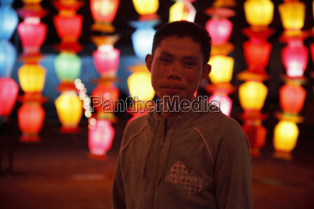 thai man stands in front of