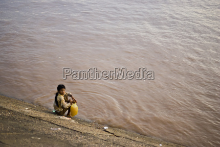 a young girl fills her water