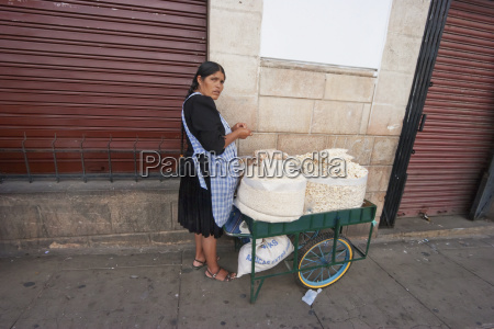 woman with a cart loaded with