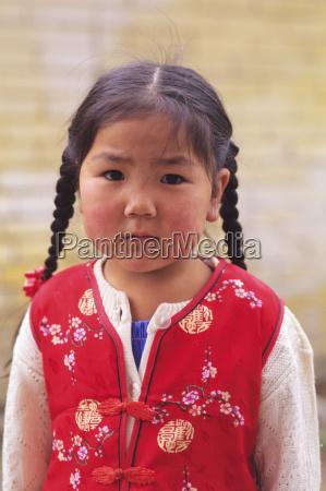mongolia girl wearing red vest ulaanbaatar