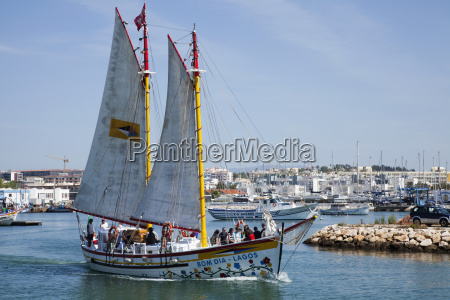 a boat with large sails travels