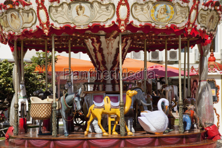a carousel ride with seats in