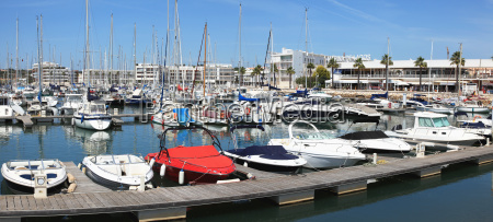 boats in a harbour lagos algarve