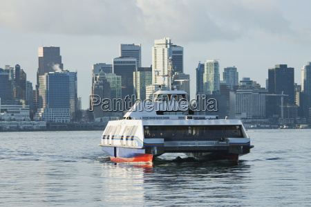 sea bus and skyline of vancouver