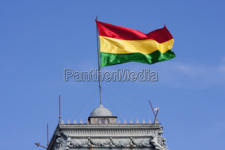 bolivian flag atop the government palace