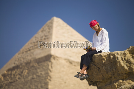 a female tourist reads a guide