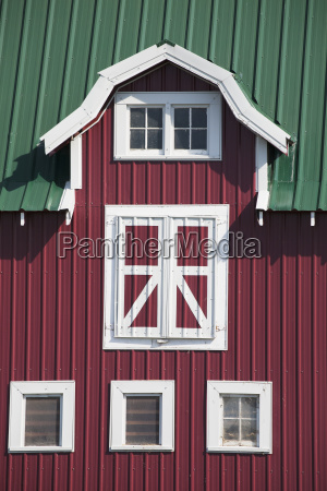 red barn with white trim and