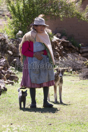 old tarabuco woman with her dog