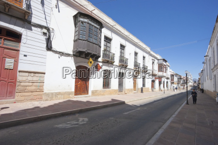 enclosed balconies on houses along calle