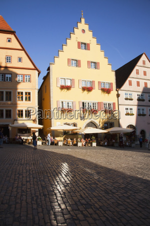 people in the marketplace and buildings