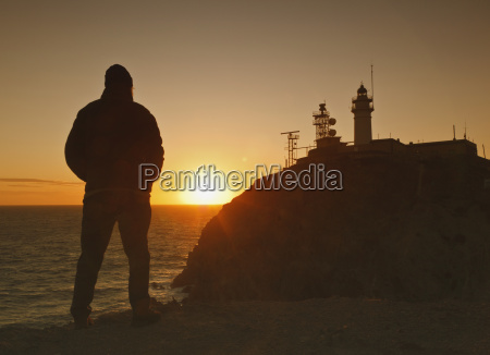 silhouette of a person standing and