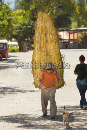 a man carrying a bundle of