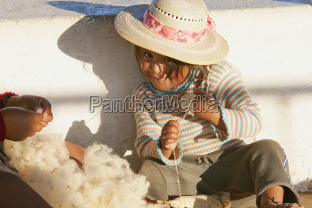 girl spindling cotton sucre chuquisaca department