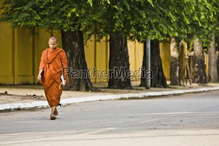 a buddhist monk walks the streets