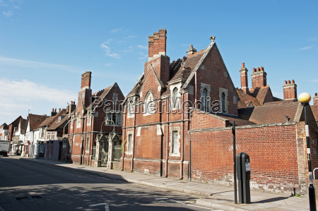 brick buildings with chimneys along a
