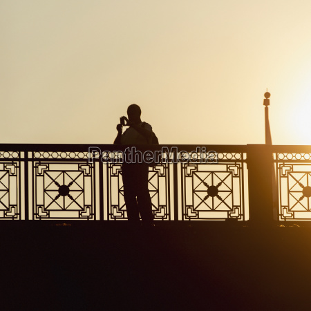 silhouette of a person standing at