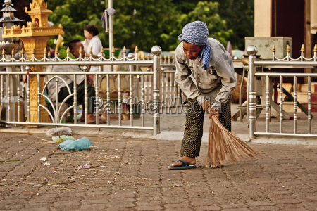a sweeper cleans up after the