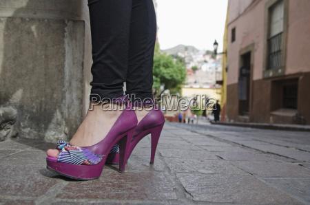 womans feet in high heel purple
