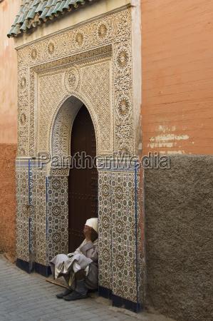 morocco marrakech medina senior man sitting
