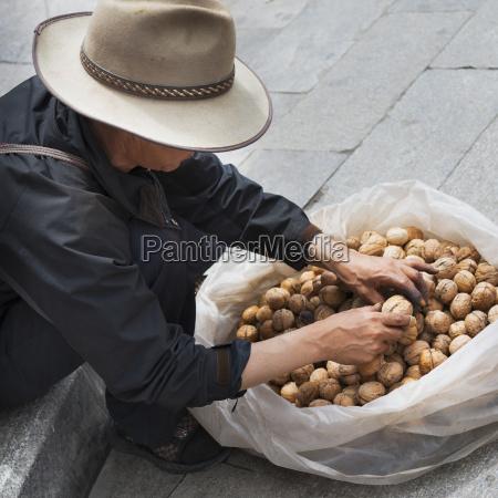 man sitting on curb of street