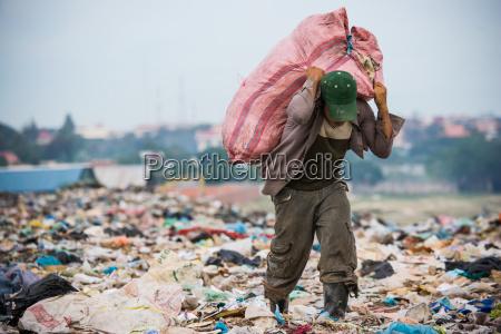 cambodia boy working at city trash
