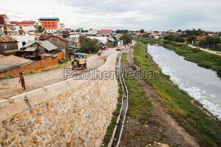 cambodia river running through slums phnom