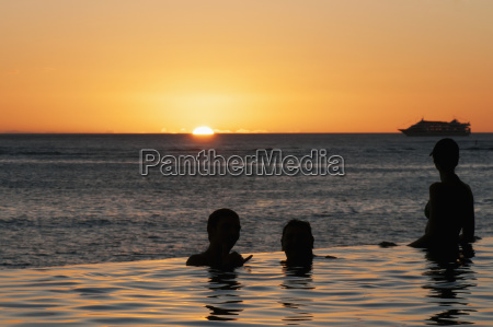 people in an infinity pool at