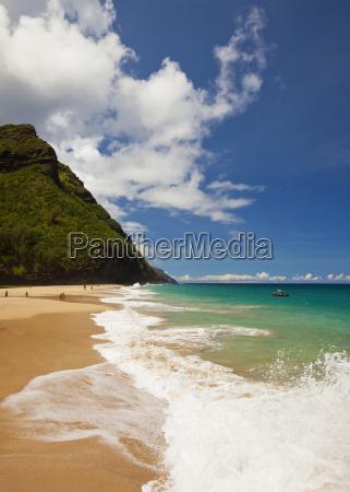 waves splash on this beach along