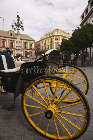 black and yellow horse drawn carriage