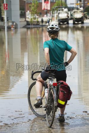 a woman sits on her bike