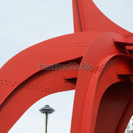 red metal sculpture with the space