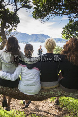 a group poses in a tree