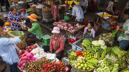 shoppers and vendors at the phnom