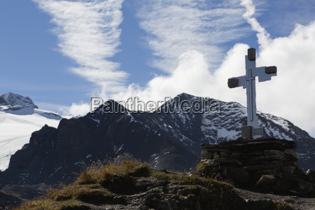 large cross on mountain peak with