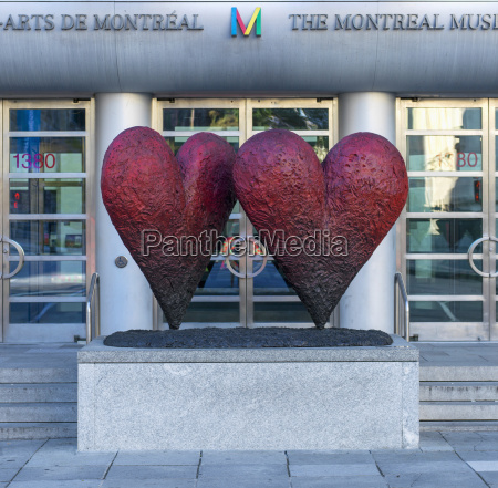 sculpture of two red hearts at