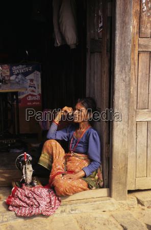 nepal gorkha village woman sitting on