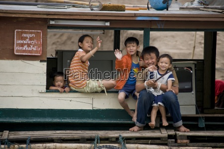 family living on a houseboat luang