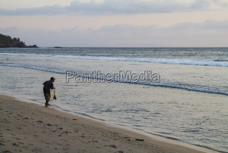 fisherman casting his net in the